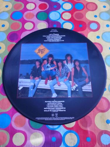bon jovi lp let it rock 1986. fotodisco