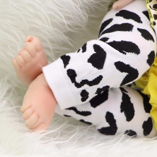 boneca reborn laço amarelo em promoção por 425,00 reais