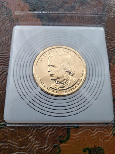bonita moneda de un dolar  - enchapada en oro- solo $24500