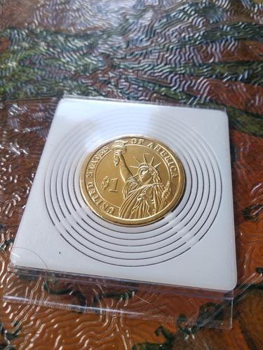 bonita moneda de un dolar  - enchapada en oro - solo $29500