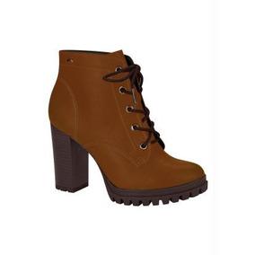 50dc30e74ac02 Sapatos Pretos Fechados De Salto Grosso Feminino Lacoste - Botas no ...