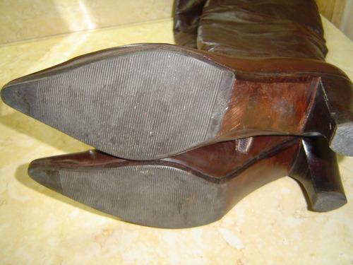 botas de cuero cabritilla de blaqué ,un guante suela febo