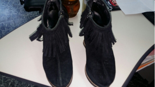 botas taco chino con flecos