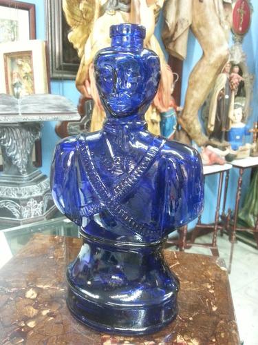 botella de licor italiana antigua en vidrio azul de guerrero