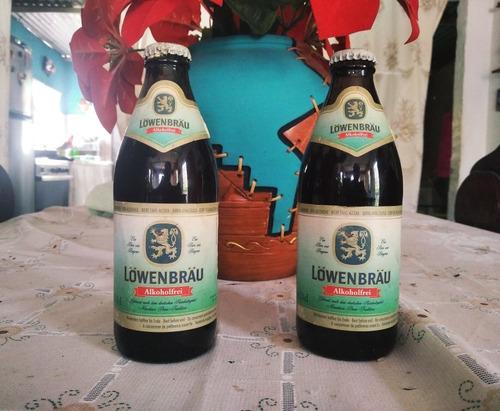 botella lowenbrau con 20 años guardada