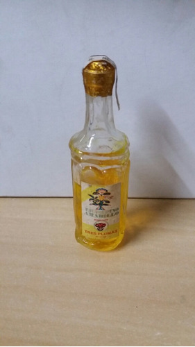 botella miniatura licor fino amarillo tres plumas