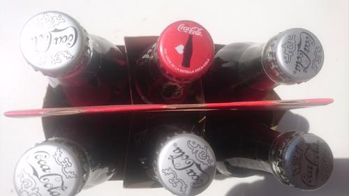 botellas de cocacola festejando 100 años