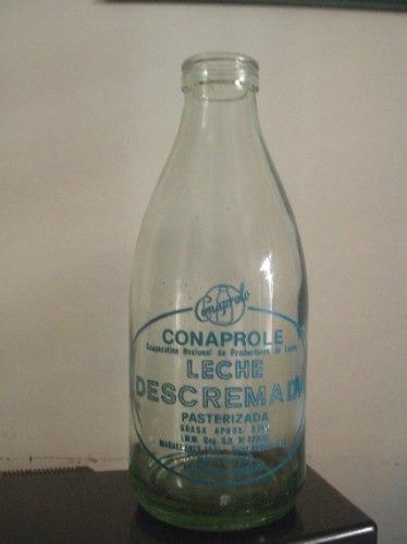 botellas leche descremada conaprole logo pintado a fuego