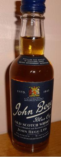 botellita de colección de whisky john begg