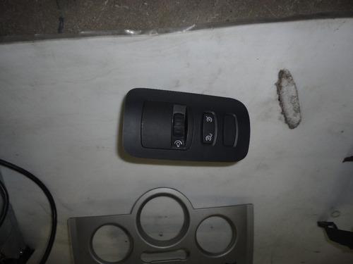 botão reulagem do farol megane 2008