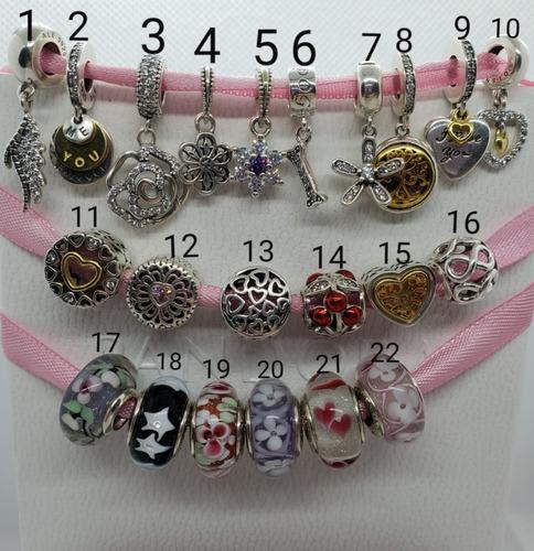 bracelete pandora rígido e um berloque