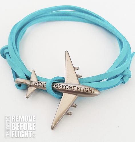 brazalete azul con avión plata - remove before flight®