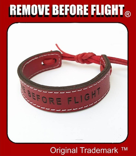 brazalete kiss me red flex - remove before flight ®
