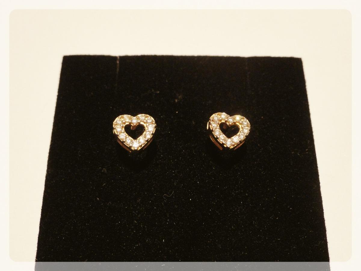 17851dfe172e6 brinco coração vazado cravejado de zircônia em ouro 18k. Carregando zoom.