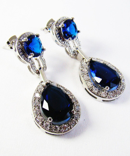 brincos com gota de cristal azul safira cercada de zirconias