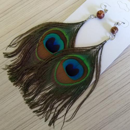brincos penas de pavão importado ref: 7984