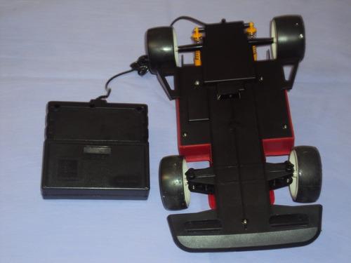 brinquedo antigo, carro de formula 1 controle remoto c/fio.