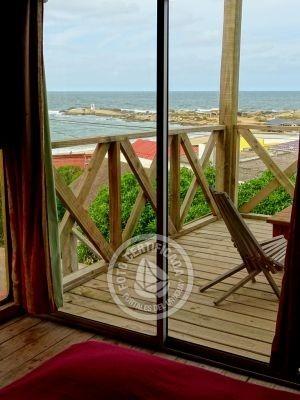 cabaña al mar con mirador de ballenas y estufa zona centro