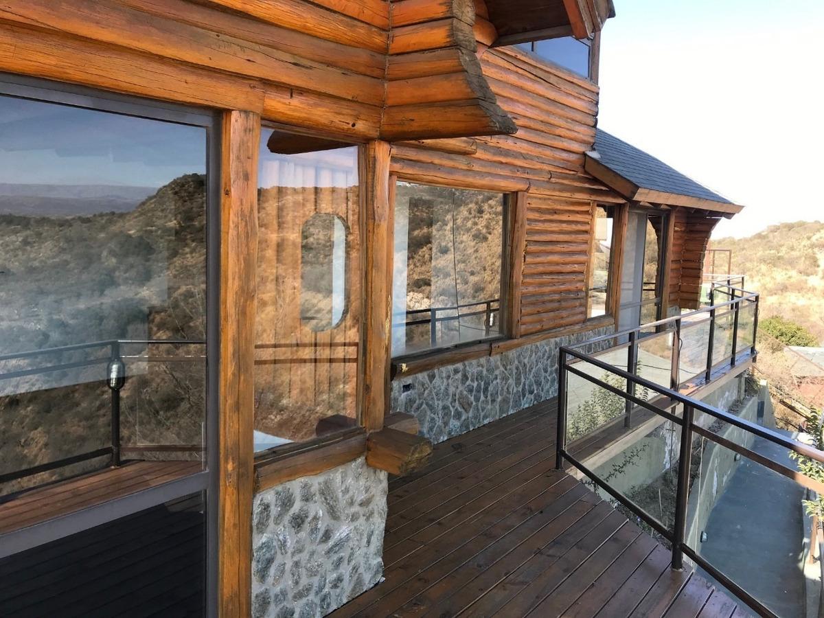 cabañas de tronco y piedra con vista panorámica al lago