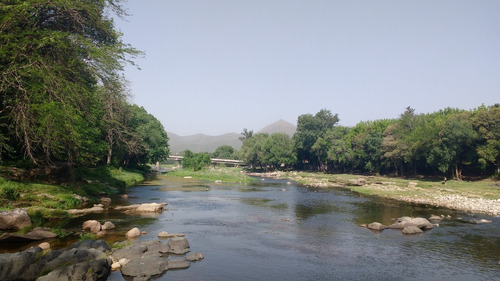 cabañas  el terreno  en cosquín frente al río