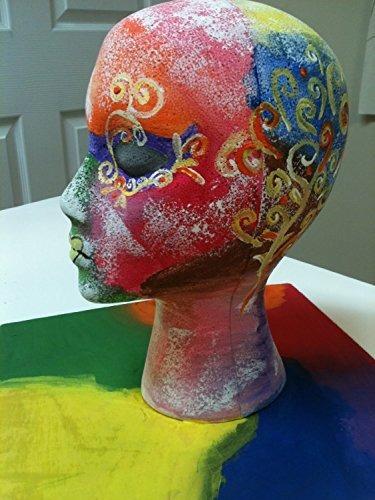 cabeza de maniqui de unicel con rostro femenino