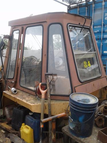 cabina case, retroexcavadora, cubiertas, tachos a medida.