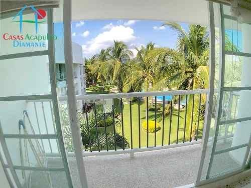 cad mayan lakes 4-301 balcón con vista al jardín y albercas