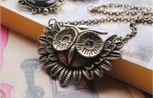 cadena collar con bonito dije de buho con alas cromado