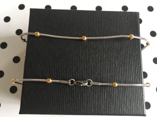 cadena de acero quirurgico con bolas doradas