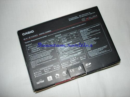 caixa manual e cd camera digital ex-z1000 casio - usada cons