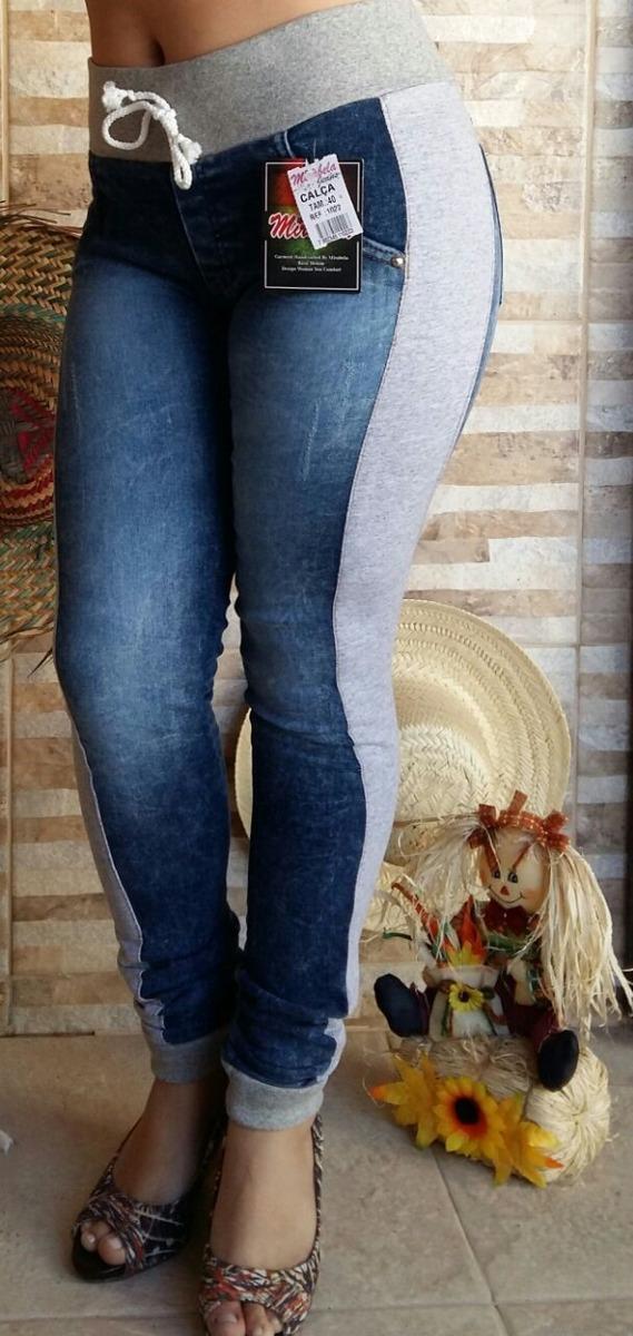 5300dd2668 calça jeans feminina destroyed cós e punho de moletom. Carregando zoom.