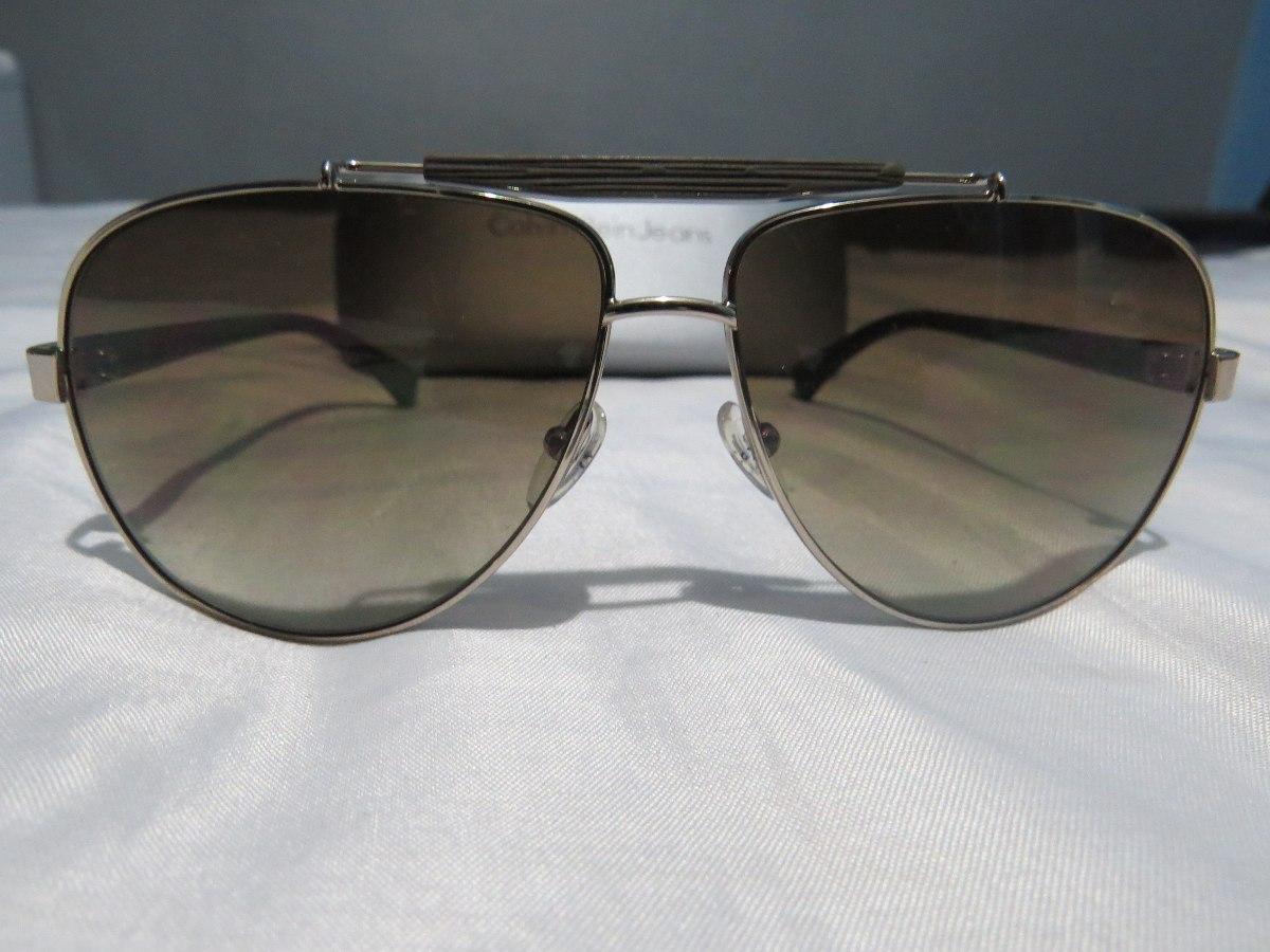 54f24a6d3e86f Óculos De Sol Aviador Calvin Klein Ckj 1186s Dourado Oferta - R  499 ...