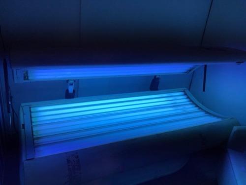cama de bronzeamento artificial