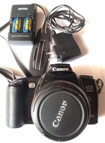 cámara analógic canon eos 3000 con cargador de pilas cr123a