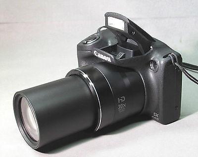 camara canon powershot sx400 is black 16 m/p zoom 30x