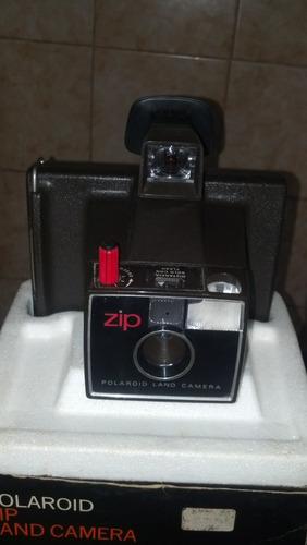 camara instantánea polaroid land funciona con pilas aa