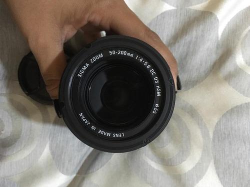 cámara nikon d3000 con accesorios
