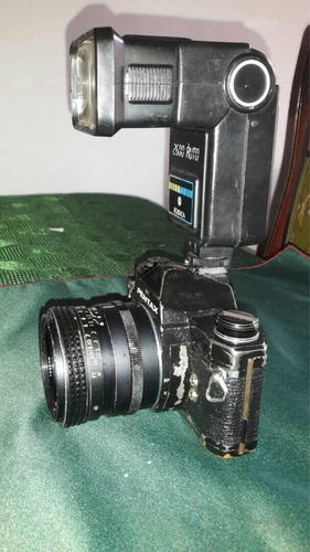 cámara pentax con 2 zoom