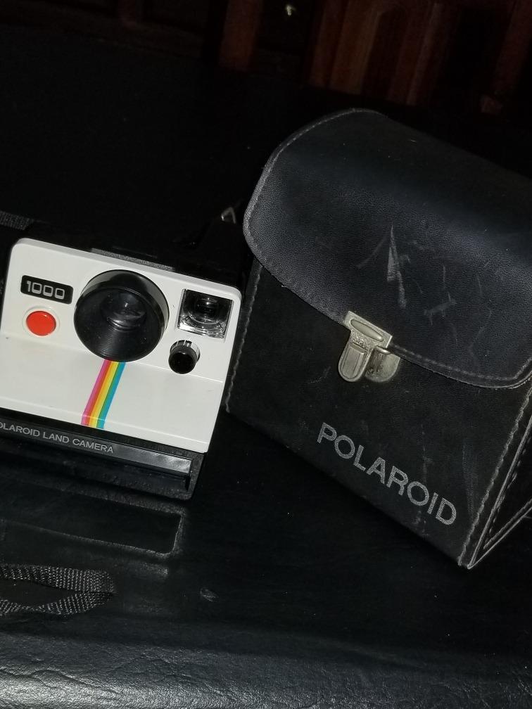 e9e8670f0b7a8   camara polaroid 1000 con estuche de cuero. Cargando zoom.