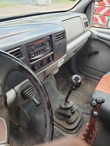 camión ford 14000 con portavolquetes