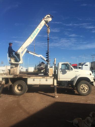 camión grúa perforadora postes