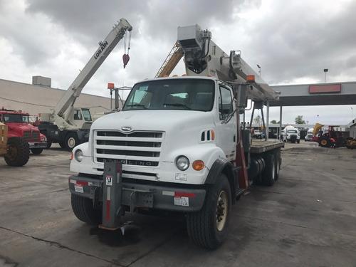 camion sterling 2003 con grua titan terex de 23.5 toneladas