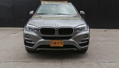 camioneta bmw x6 gris metalizada
