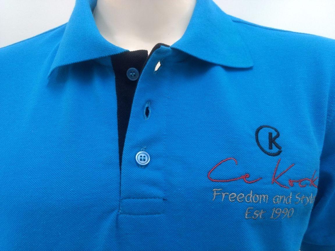 c13b3c131a camisa gola polo masculina azul turquesa brasão piquet ck. Carregando zoom.