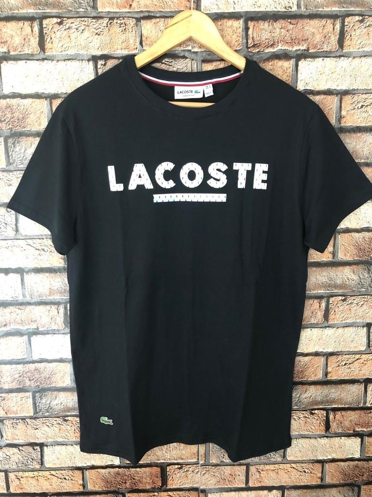 f50cbf40a5 camiseta blusa lacoste c  elastano - estampa alto relevo. Carregando zoom.