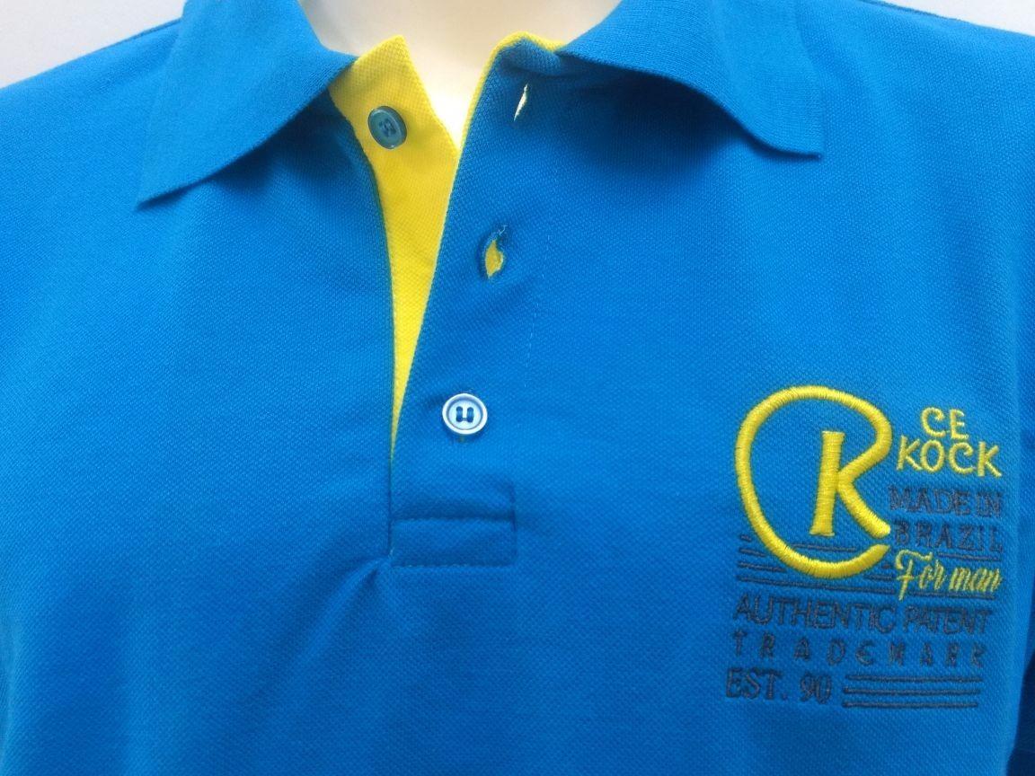 74c3668e8e camiseta gola polo masculina brasão azul turquesa piquet ck. Carregando zoom .