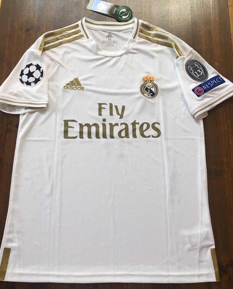 curva Nube tono  Camiseta Real Madrid Parches Champions