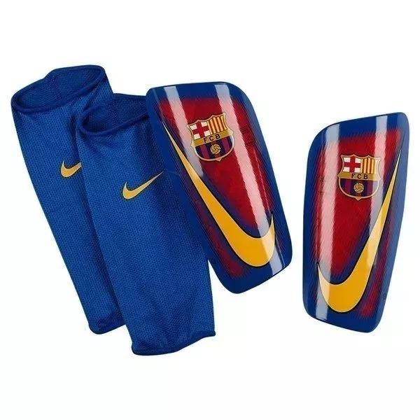 911316a884bc2 Caneleira Nike Mercurial Lite Barcelona Infantil + Nf - R$ 139,90 em ...