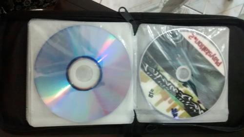 capa para cds +10 jogos de playstatio2 +2 jogos para pc
