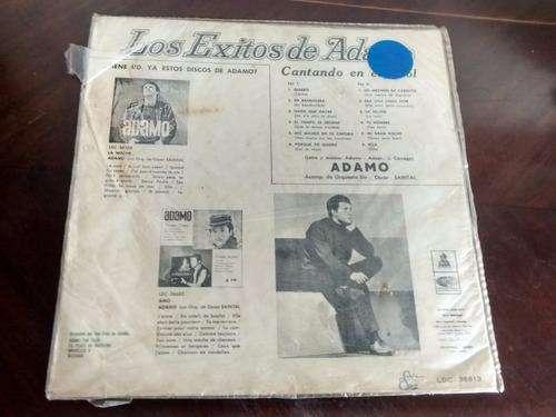 caratula de los exitos de adamo  cantando en español